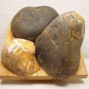 Gluing stones on blocks of wood